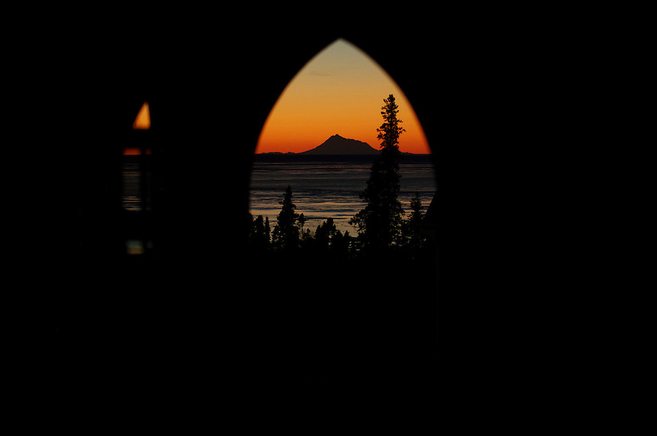 November 30, 2010, Winter sunset view across Cook Inlet of Mount Redoubt Volcano from Goldenview Park, Anchorage, Alaska, United States. (Ron Karpilo)