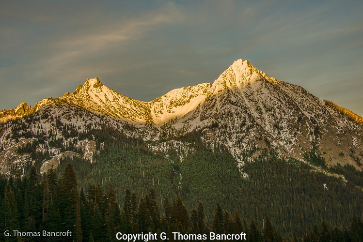 Cutthroat Peak (left) and Whistler Mountain (right) glow in the evening light.  The Pacific Crest Trail climbs around the left side of Cutthroat Peak (G. Thomas Bancroft)