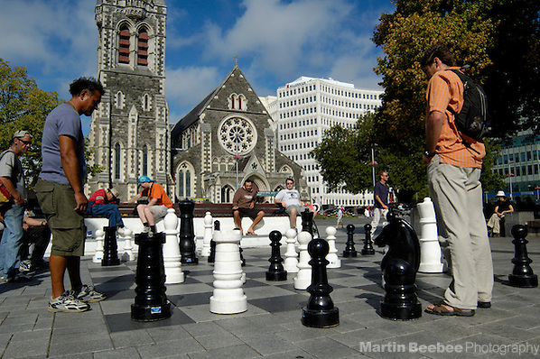 Playing outdoor chess in Cathedral Square with Christchurch Cathedral in the background, Christchurch New Zealand (Martin D. Beebee/Martin Beebee Photography)