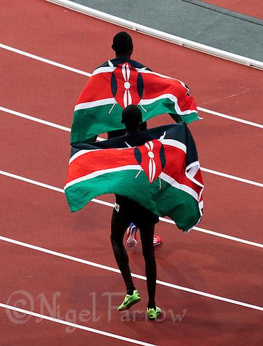 09 AUG 2012 - LONDON, GBR - David Rudisha (KEN) of Kenya (top) celebrates winning  the men's 800m final with bronze medalist Timothy Kitum (KEN) also of Kenya at the London 2012 Olympic Games athletics in the Olympic Stadium, Stratford, London, Great Britain  .(PHOTO (C) 2012 NIGEL FARROW) (NIGEL FARROW/(C) 2012 NIGEL FARROW)