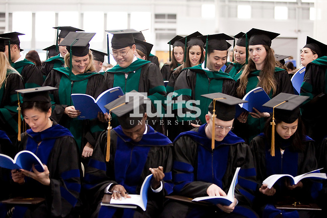 05/22/2011- Medford, Mass. - Tufts Medical graduates complete their degrees by reciting the Hippocratic Oath as Sackler students, front, follow along, during commencement for the Tufts University School of Medicine on May 22, 2011. (Kelvin Ma/Tufts University) (Kelvin Ma/Tufts University)