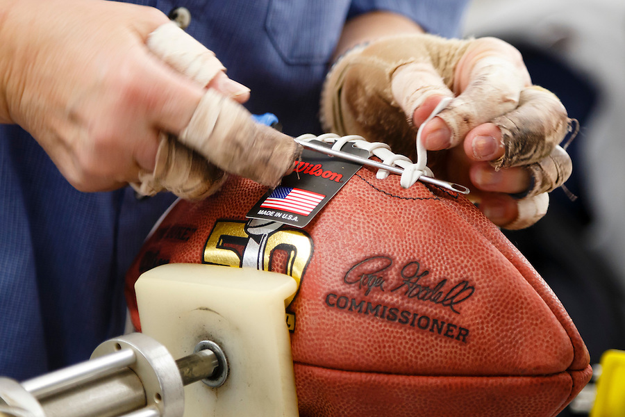 Donna Conley laces an official ball for the NFL Super Bowl 50 football game at the Wilson Sporting Goods Co. in Ada, Ohio, Tuesday, Jan. 26, 2016. The Denver Broncos will play the Carolina Panthers in the Super Bowl on Feb. 7 in Santa Clara, CA. (AP Photo/Rick Osentoski) (Rick Osentoski/AP)