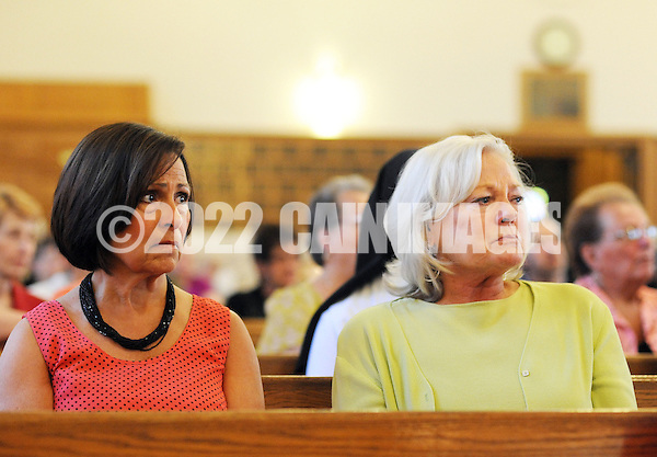 BRISTOL, PA - MAY 31:  Monica DiGuiseppe and Robyn Trunell, both of Bristol, Pennsylvania tear up after the closing of St. Ann's parish is announced May 31, 2014 in Bristol, Pennsylvania. (Photo by William Thomas Cain/Cain Images) (William Thomas Cain)