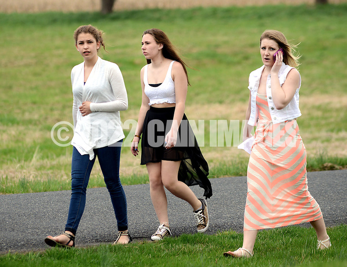SOUDERTON, PA - APRIL 14:  From left, Amber Figueroa, Hannah Fisher and Sophie Arnott walk from the school building after a bomb threat forced the evacuation of Souderton High School April 14, 2014 in Souderton, Pennsylvania. (Photo by William Thomas Cain/Cain Images) (William Thomas Cain)