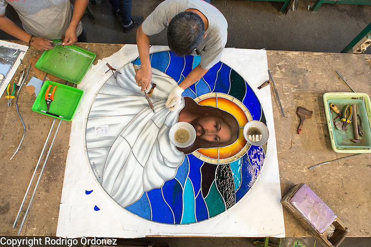 An employee wields a stained glass window of Jesus Christ at the Eztu Glass factory in Tangerang, near Jakarta, Indonesia, on July 2, 2015. Indonesia is the country with the world's largest Muslim population, of about 205 million people. Roughly 88% of Indonesia's population is Muslim, and the nation is home to about 13% of the world's Muslims. (Rodrigo Ordonez)