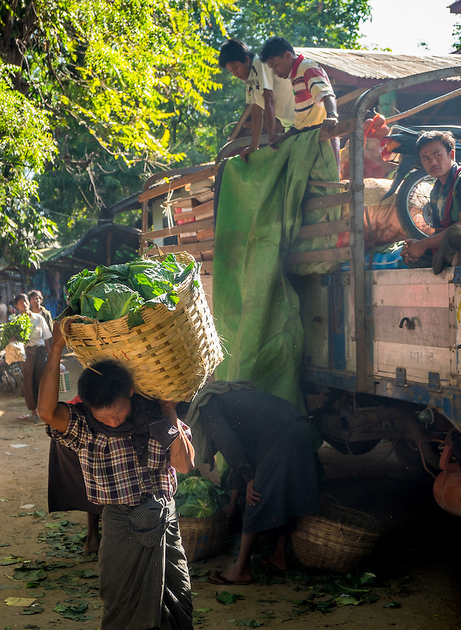 BAGAN, MYANMAR - CIRCA DECEMBER 2013: Man carrying vegetables in the Nyaung U market close to Bagan in Myanmar (Daniel Korzeniewski)