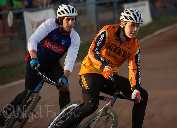 13 SEP 2014 - IPSWICH, GBR - Ben Mould of Wednesfield Aces (right) leads Josh Brooke (left) of Ipswich round a bend during the run off to decide the winner of the 2014 British Open Club Cycle Speedway Championship final at Whitton Sports & Community Centre in Ipswich, Great Britain (PHOTO COPYRIGHT © 2014 NIGEL FARROW, ALL RIGHTS RESERVED) (NIGEL FARROW/COPYRIGHT © 2014 NIGEL FARROW : www.nigelfarrow.com)