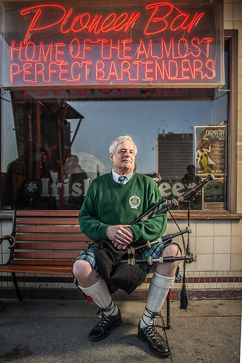 Piper, Tim Kincaid, in front of Pioneer Bar on Saint Patrick's Day (Clark James Mishler)