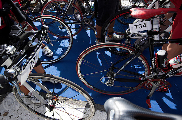 18 SEP 2011 - LA BAULE, FRA - Competitors wait to rack their bikes before the start of the Triathlon Courte Distance (Olympic or standard distance) at the 24th Triathlon Audencia in La Baule, France .(PHOTO (C) NIGEL FARROW) (NIGEL FARROW/(C) 2011 NIGEL FARROW)