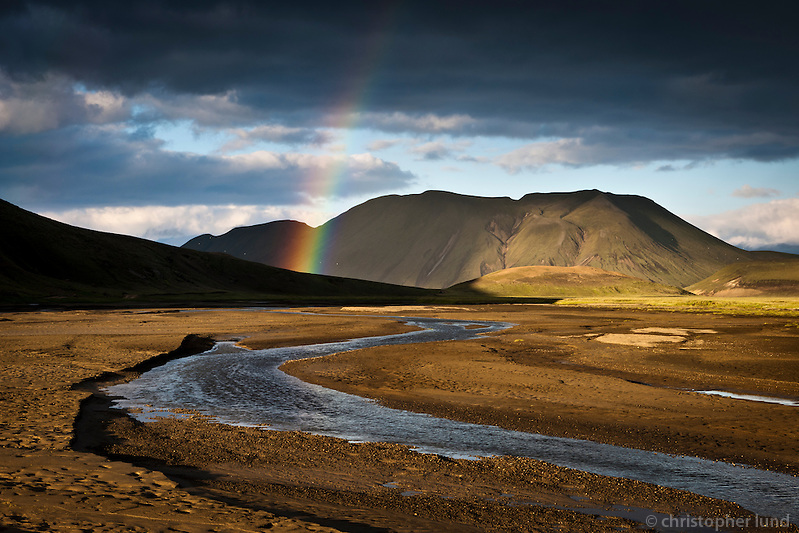 Evening at Fjallabak Nature Reserve, Interior of Iceland. Small stream near Landmannahellir, a rainbow glows in evening light over Mount Lifrarfjöll. (Christopher Lund/©2010 Christopher Lund)