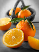 Fresh oranges whole and cut halves with leaves (Paul Williams)