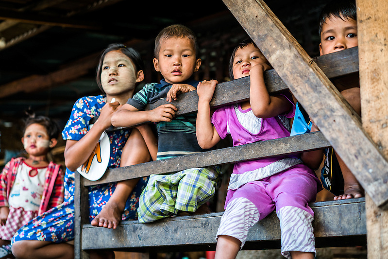 MYITKYINA, MYANMAR - MARCH 13th, 2016: Youngsters in Shwezet IDP village. Nearly 500 people were forced to relocate here in 2011 because of escalated fighting between the Kachin Independence Army, KIA, and the Burmese government, which has been in various states of conflict since 1994. (Quinn Ryan Mattingly/For The Washington Post)
