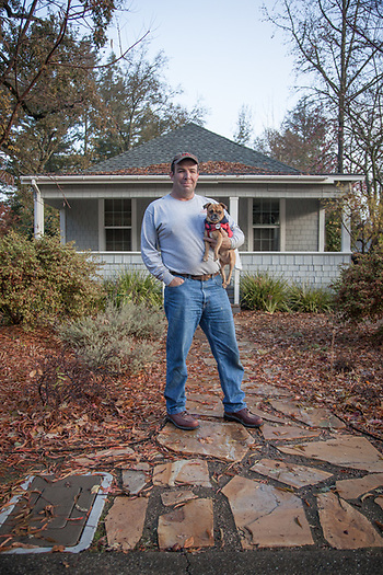 "Contractor Hal Leggett with his dog, Cooper, on the first day of a one year renovation project on a home in Calistoga.  ""Today I am establishing a beachhead...this will be a long term project."" (© Clark James Mishler)"
