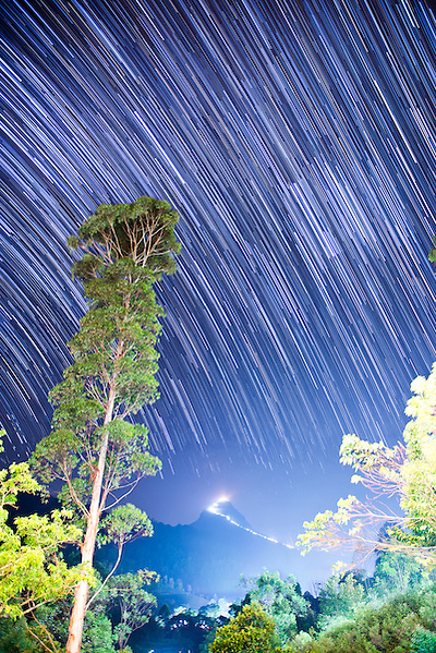 Photo of star trails over Adams Peak (Sri Pada), Central Highlands, Sri Lanka, Asia. This is a photo of star trails over Adams Peak (Sri Pada), Central Highlands, Sri Lanka, Asia. As climbing Adams Peak (Sri Pada) requires a 2am start in order to reach the summit by sunrise, a photo of star trails seemed very appropriate.