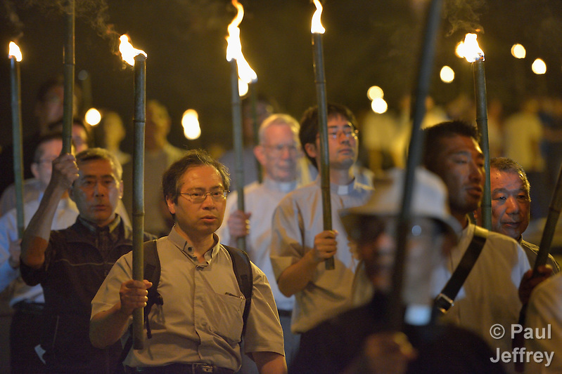 Priests participate in a torchlight march for peace in Nagasaki, Japan, on August 9, 2015, the 70th anniversary of the day the United States dropped an atomic bomb on the city. The procession began with a mass at the Urakami Cathedral--which was destroyed by the bombing and rebuilt years later. (Paul Jeffrey)