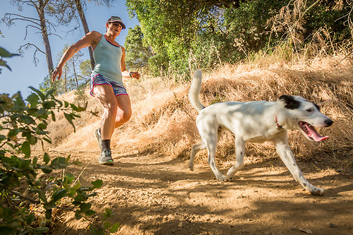 Rachel Melick runs with her dog, Zeke, on Oak Hill Mine Trail in Calistoga. (Clark James Mishler)