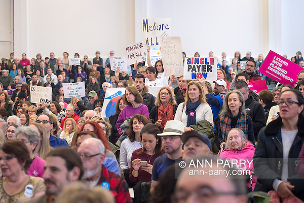 "Westbury, New York, USA. January 15, 2017. Hundreds of people, many with protest signs, are in the audience at the ""Our First Stand"" Rally against Republicans repealing the Affordable Care Act, ACA, taking millions of people off health insurance, making massive cuts to Medicaid, and defunding Planned Parenthood. It was one of dozens of nationwide Bernie Sanders' rallies for health care that Sunday. (Ann Parry/Ann Parry, ann-parry.com)"