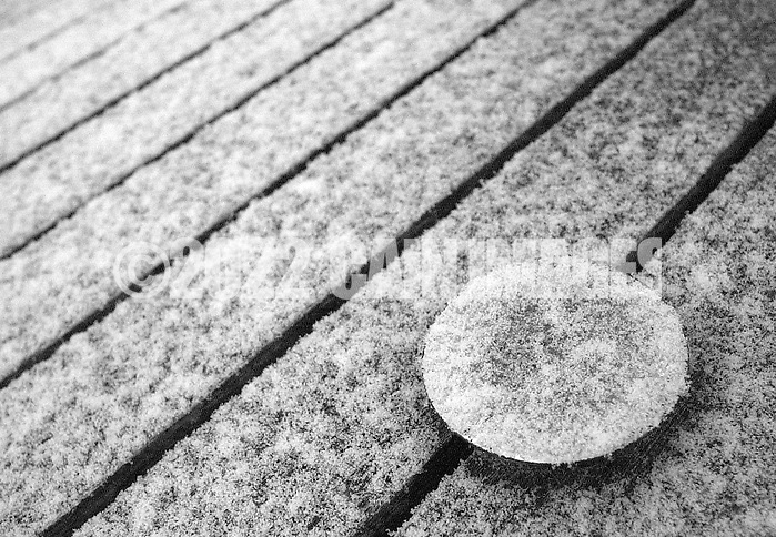 HARTSVILLE, PA - MARCH 26:   A snow covered umbrella cap rests upon a teak dining table March 26, 2014 in Hartsville, Pennsylvania. (Photo by William Thomas Cain/Cain Images) (William Thomas Cain)