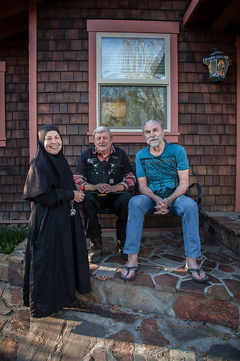 Mother Tabitha with Environmental consultant, Kurt Larrecou,  and retired carpenter, George Meyer in front of George's house at the corner of Third and Washington in Calistoga, CA (Clark James Mishler)