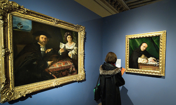 "VENICE, ITALY - NOVEMBER 23:  A woman stands between ""Ritratto di due Coniugi"" and ""Ritratto di un Domenicano"" at the press preview of Tribute to Lorenzo Lotto - The Hermitage Paintings at Accademia Gallery on November 23, 2011 in Venice, Italy. The exhibition which includes two very rare & never seen before paintings opens from the 24th November 2011 to 26th February 2012 in Italy. (Marco Secchi/Getty Images)"