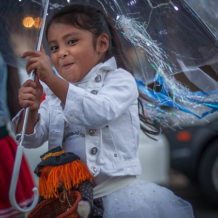 Six year old Paula Lopez with her umbrella in the Holloween Parade in Calistoga, CA (© Clark James Mishler)
