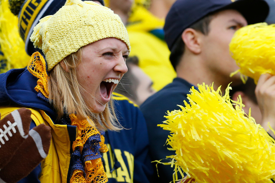 Oct 17, 2015; Ann Arbor, MI, USA; Michigan Wolverines fan cheers durning the game against the Michigan State Spartans in the first half at Michigan Stadium. Mandatory Credit: Rick Osentoski-USA TODAY Sports (Rick Osentoski/Rick Osentoski-USA TODAY Sports)