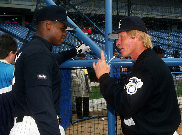 CHICAGO - 1993:  Frank Thomas of the Chicago White Sox talks with White Sox hitting coach Walt Hriniak during batting practice prior to an MLB game at Comiskey Park in Chicago, Illinois.  Thomas played for the White Sox from 1990-2005. (Photo by Ron Vesely) (Ron Vesely)