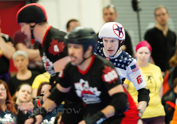 16 MAR 2014 - BIRMINGHAM, GBR - Team USA jammer Jonathan R (right) looks for a way past Team Canada blockers during the bout between the two teams at the inaugural Men's Roller Derby World Cup at the Futsal Arena in Birmingham, West Midlands, Great Britain (PHOTO COPYRIGHT © 2014 NIGEL FARROW, ALL RIGHTS RESERVED) (NIGEL FARROW/COPYRIGHT © 2014 NIGEL FARROW : www.nigelfarrow.com)