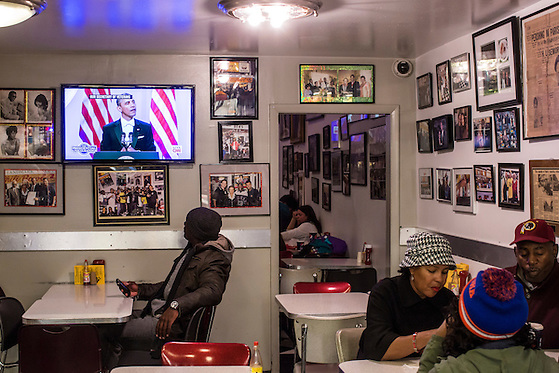 Dewayn Lewis of Washington, DC, watches President Barack Obama speak at the Inaugural Ball at Ben's Chili Bowl, a local institution which President Barack Obama has visited, on Monday, January 21, 2013 in Washington, DC. (Brendan Hoffman/Brendan Hoffman for the New York Times)