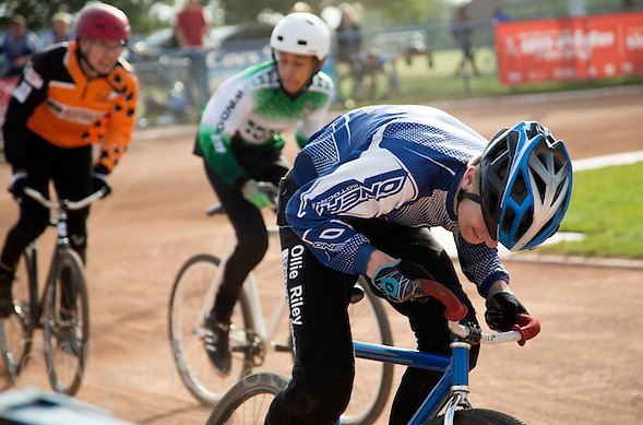 13 SEP 2014 - IPSWICH, GBR - Ollie Riley from Hethersett Hawks pushes himself on during a heat of the Minor Final at the 2014 British Open Club Cycle Speedway Championships at Whitton Sports & Community Centre in Ipswich, Great Britain (PHOTO COPYRIGHT © 2014 NIGEL FARROW, ALL RIGHTS RESERVED) (NIGEL FARROW/COPYRIGHT © 2014 NIGEL FARROW : www.nigelfarrow.com)