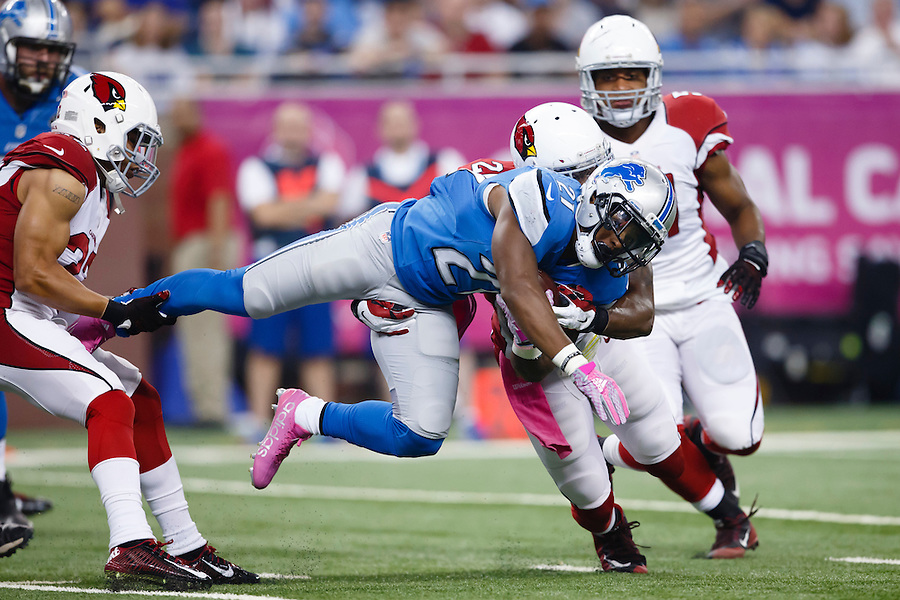 Detroit Lions running back Ameer Abdullah (21) is stopped by Arizona Cardinals free safety Tyrann Mathieu, left, and strong safety Deone Bucannon, right, during the first half of an NFL football game, Sunday, Oct. 11, 2015, in Detroit. (AP Photo/Rick Osentoski) (Rick Osentoski/AP)