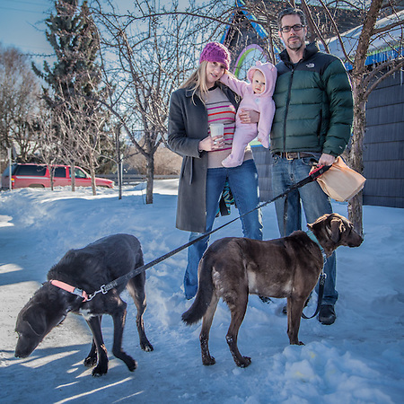 "Neighbors Erika Kahill and Jim Adams with their daughter Clementine and dogs Milo and Emma in Anchorage's South Addition neighborhood.  ""We just needed to get out into the sunshine.""  erika.kahill@alaska.gov (© Clark James Mishler)"