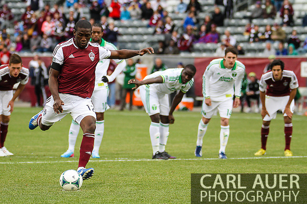 March 30th, 2013 Commerce City, CO - After a penalty in the goal box, Colorado Rapids midfielder Hendry Thomas (12) scores on a penalty kick in the second half of the MLS match between the Portland Timbers and the Colorado Rapids at Dick's Sporting Goods Park in Commerce City, CO (Carl Auer/Newsport)