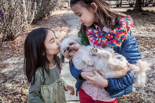 """Sharkey is 17 years old and going down hill quickly.  We wanted some photographs of her with the kids.""  -Meghan Kim and her daughters Kisun and Minsun, Anchorage (© Clark James Mishler)"