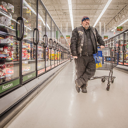 "Tom Evans, credit Manager for Airliquide, shops at Walmart in midtown Anchorage.  Lived in Anchorage since age 12.  ""I have a love/hate relationship with Anchorage""       tomvns@yahoo.com (© Clark James Mishler)"