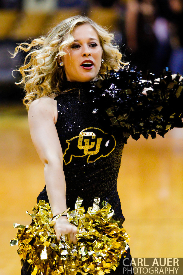 November 13th, 2013:  A Colorado Buffaloes cheerleader prior to the start of action in the NCAA Basketball game between the University of Wyoming Cowboys and the University of Colorado Buffaloes at the Coors Events Center in Boulder, Colorado (Carl Auer/ZUMAPRESS.com)