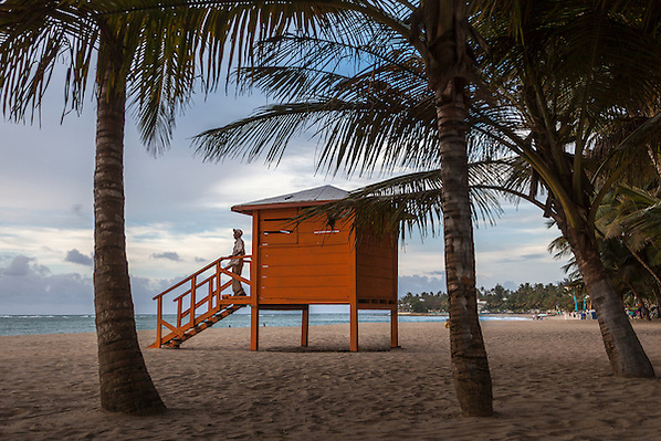 A man stands on the landing of a beach guard house in Cabarete, Puerta Plata, Dominican Republic. (Robert Englebright)