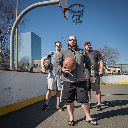"Mark Hoffman (left), Greg Conners (center), and J.C. Durate (right) at the Delaney hockey rink and basketball court, Anchorage  ""We all met while working at the Glacier Brew House…we're all still in the hospitality business>"" (© Clark James Mishler)"