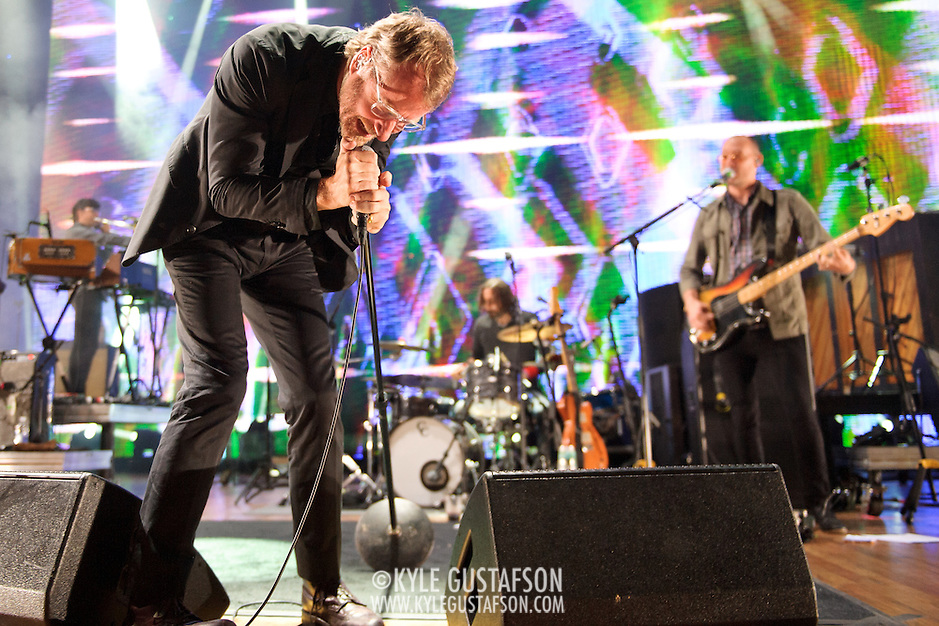 COLUMBIA, MD - June 6th,  2013 -   Matt Berninger, Bryan Devendorf and Scott Devendorf of The National perform on a rainy night at Merriweather Post Pavilion in Columbia, MD.  The band just released their sixth studio album, Trouble Will Find Me, which debuted at No. 3 on both the US and UK album charts. (Photo by Kyle Gustafson/For The Washington Post) (Kyle Gustafson/FTWP)