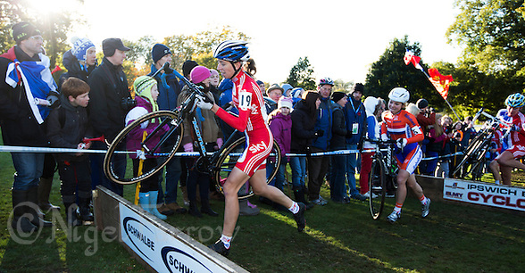 03 NOV 2012 - IPSWICH, GBR - Helen Wyman (GBR) (left) of Great Britain prepares to clear a hurdle during the Elite Women&#039;s European Cyclo-Cross Championships in Chantry Park, Ipswich, Suffolk, Great Britain (PHOTO (C) 2012 NIGEL FARROW) (NIGEL FARROW/(C) 2012 NIGEL FARROW)