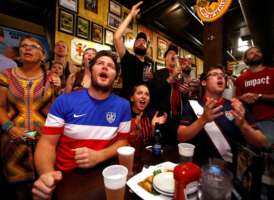 Fans react while watching the United States-Germany World Cup game Thursday at the Royal Mile in Des Moines. (Christopher Gannon/The Register)