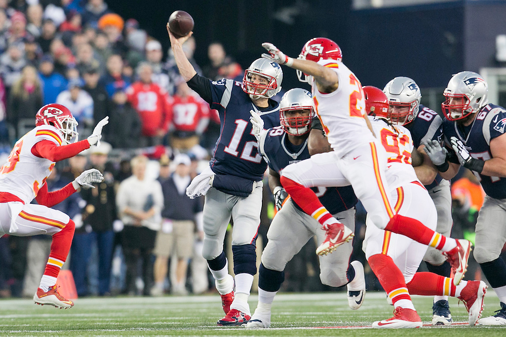 New England Patriots quarterback Tom Brady (12) passes through an opening in the Kansas City Chiefs defense in the first quarter of the AFC Divisional Playoff game at Gillette Stadium in Foxborough, Massachusetts on January 16, 2016.(KELVIN MA/UPI)