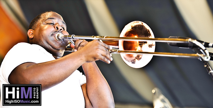 Young Pinstripe Brass Band playing at Jazz Fest on Day 1. (Golden G. Richard III)