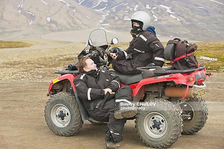 LONGYEARBYEN, NORWAY - SEPTEMBER 01, 2011: Unidentified people enjoy off-road vehicle excursion in Longyearbyen, Norway. (Dmitry Chulov)