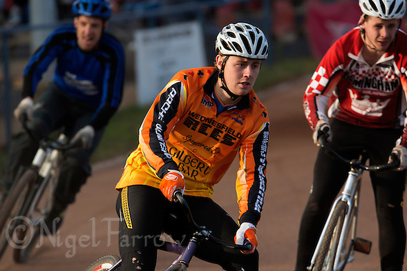 13 SEP 2014 - IPSWICH, GBR - Ben Mould (centre) of Wednesfield Aces takes a corner during a heat of the 2014 British Open Club Cycle Speedway Championship final at Whitton Sports & Community Centre in Ipswich, Great Britain (PHOTO COPYRIGHT © 2014 NIGEL FARROW, ALL RIGHTS RESERVED) (NIGEL FARROW/COPYRIGHT © 2014 NIGEL FARROW : www.nigelfarrow.com)