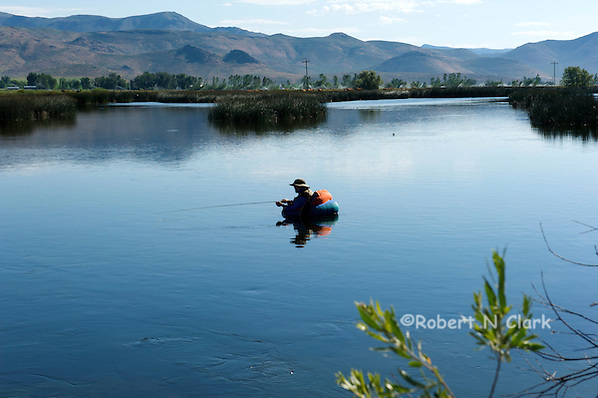 A fly fisherman in his float tube enjoys early morning fishing on Silver Creek (Bob Clark)