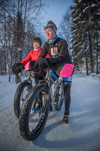 "Jacques Boutet and his sixteen year old daughter, Maddy, on their fat tire bikes on the Coastal Trail near Valley of the Moon Park, Anchorage.  ""The Anchorage trail system is what we love above Anchorage.  We use the trails year 'round.""  -Jacque Boutet (Clark James Mishler)"