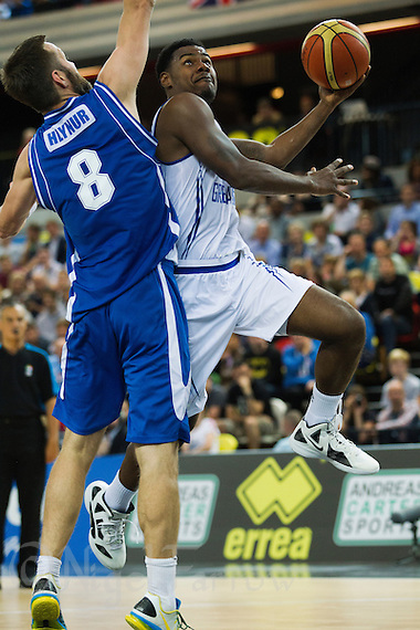 20 AUG 2014 - LONDON, GBR - Kyle Johnson (GBR) (right in white) from Great Britain attempts to score as he tries to avoid a challenge from Hlynur Baeringsson (ISL) (left) from Iceland during their men's 2015 EuroBasket 3rd Qualifying Round game at the Copper Box Arena in the Queen Elizabeth Olympic Park in Stratford, London, Great Britain (PHOTO COPYRIGHT © 2014 NIGEL FARROW, ALL RIGHTS RESERVED) (NIGEL FARROW/COPYRIGHT © 2014 NIGEL FARROW : www.nigelfarrow.com)