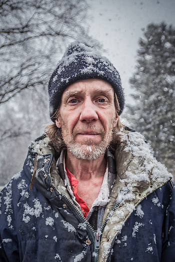 """I grew up in Anchorage…I don't have an email or a phone number…I don't even have a place to live""  -Timmy Bush in Anchorage's South Addition neighborhood during a late afternoon snow storm. (© Clark James Mishler)"