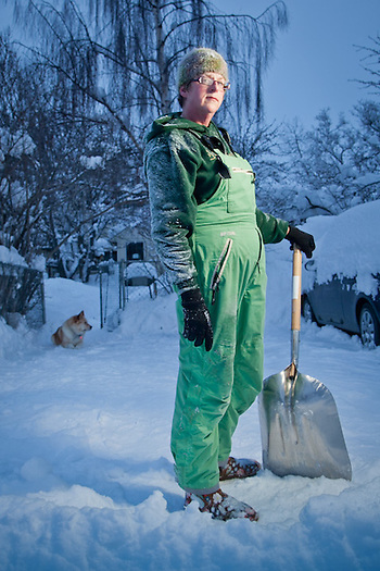 My neighbor, Wendy Isbell, shovels snow in alley behind her house, South Addition, Anchorage, Alaska (Clark James Mishler)